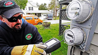 Worker checks radio frequencies emitted from a smart meter. / Image Credit- Toby Talbot:AP Photo