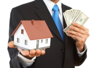 businessman with mini house and US dollars