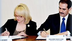 Governor Brewer and Sonora Governor Padres join forces at the Arizona-Mexico Commission's Plenary Session in Hermosillo, Sonora, Mexico, to discuss ways to boost international trade relations and economic competitiveness in the region. / Gov. office photo