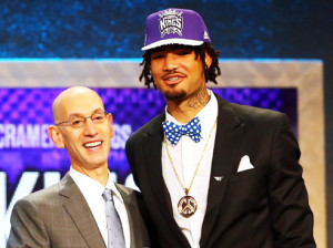Willie Cauley-Stein was taken by the Sacramento Kings with the No. 6 overall pick Thursday night. The shorter guy is NBA Commissioner Adam Silver./ Getty Images