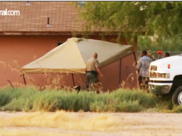 A tent structure covers the bodies of a missing Maricopa couple. /from video