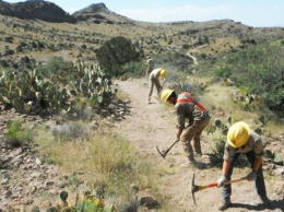 Trail Restoration Project. Portions of revenue from renewable energy development can be reinvested into local communities to help offset some of the impacts on wildlife and their habitat./ Southwest Conservation Corps