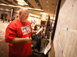 Union organizing committee member Rickey Baker marks off the names of employees who filled out a union card at the Graton Resort & Casino in Rohnert Park, June 17, 2014. /CHRISTOPHER CHUNG: PD FILE