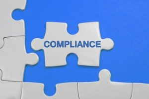 Compliance word on white puzzle - Business Concept