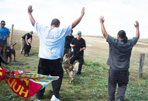 Native American protesters are confronted by a security team with dogs as they protest the Dakota Access oil pipeline near Cannonball, North Dakota, on September 3. /Getty